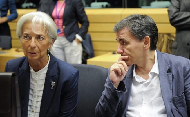 Шефът на МВФ Кристин Лагард и гръцкият финансов министър Евклидис Цакалотос