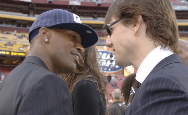 Джейми Фокс и Том Круз на футболен мач през 2006 г.
