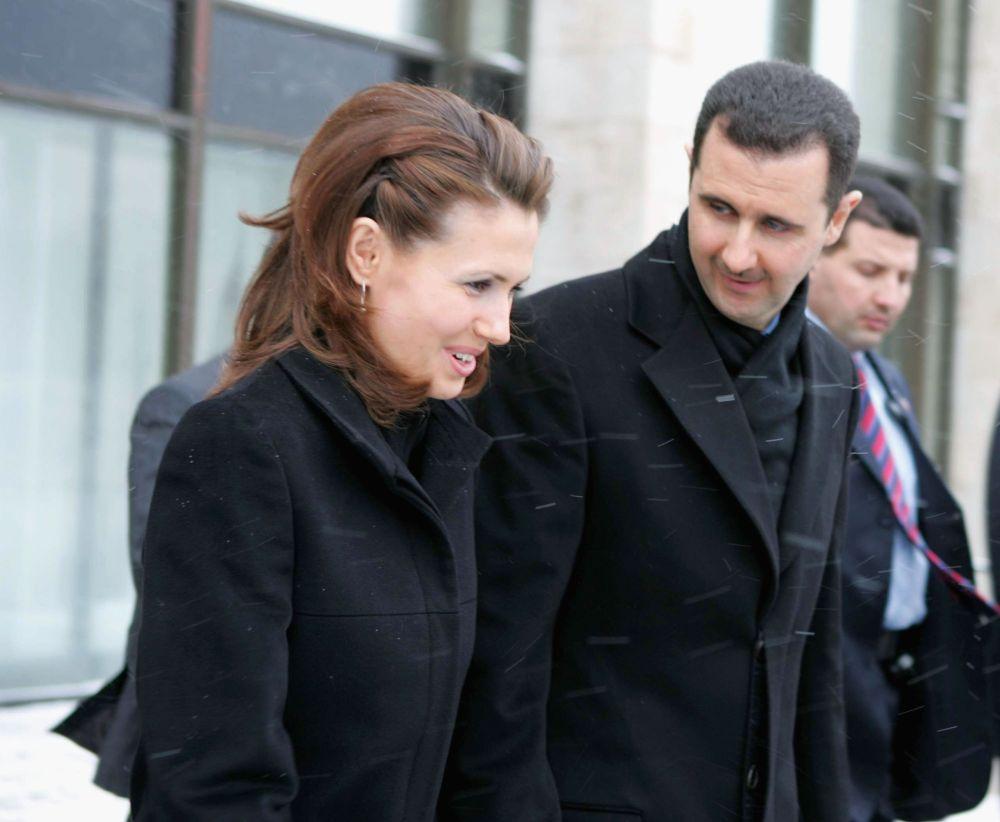 Президентът на Сирия Башар Асад и съпругата му Асма.