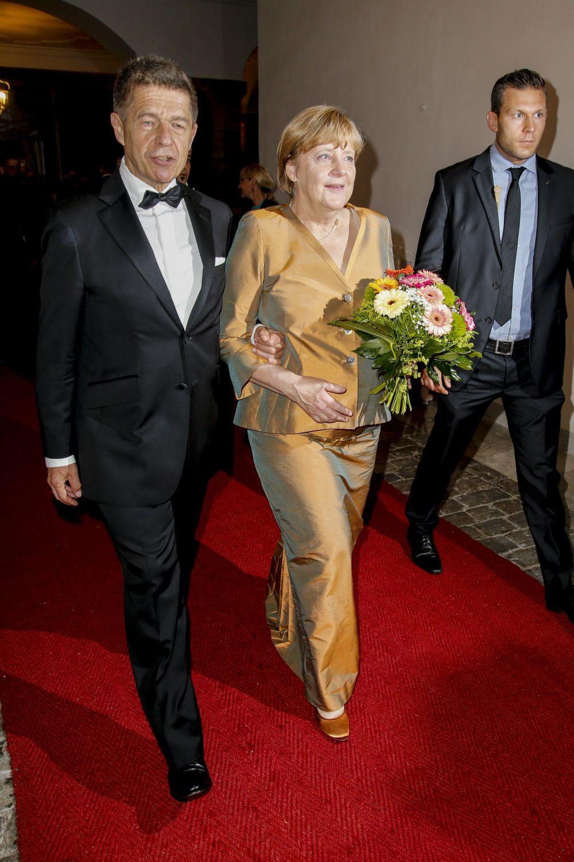 Германският канцлер Ангела Меркел и съпругът й Йоахим.