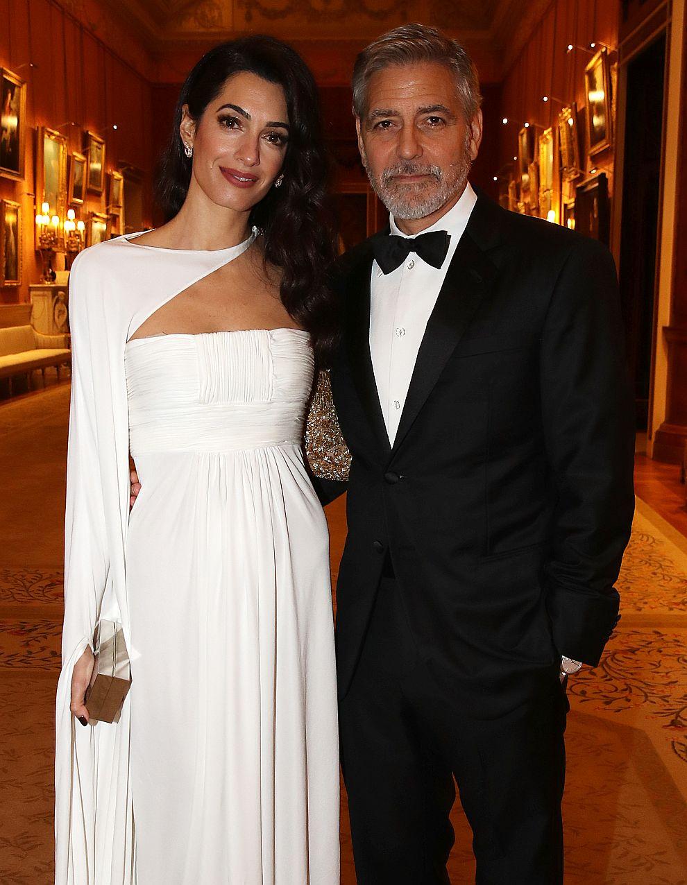 Джордж и Амал Клуни в Бъкингамския дворец