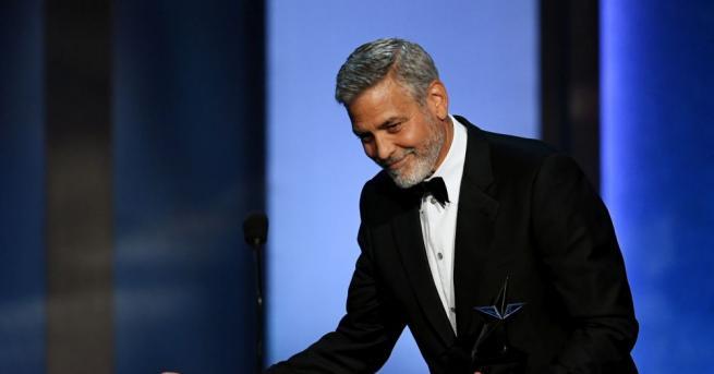 Американският актьор Джордж Клуни и съпругата му Амал, която е