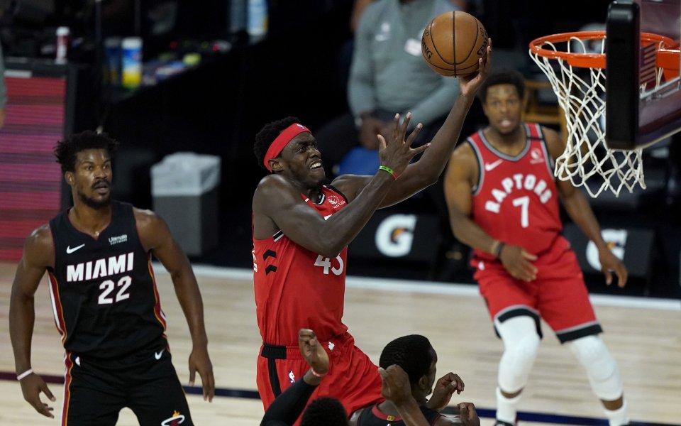 Отборът на Торонто Раптърс надви Маями Хийт със 107:103 точки