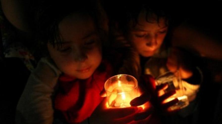 Кибератаката по социалните мрежи предшестваше годишнината от конфликта между Грузия и Русия, отбелязана в град Гори със запалени свещи.