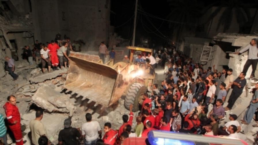 Властите показват сграда в Триполи, за която твърдят, че е разрушена от бомби на НАТО (снимката е разпространена от либийските власти)
